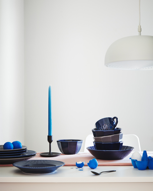 Plates, mugs and bowls in STRIMMIG dinnerware series made in dark-blue earthenware with a floral relief pattern.