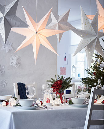 A table prepared for the festive winter season with STRÅLA lighting and VINTERFEST tableware.