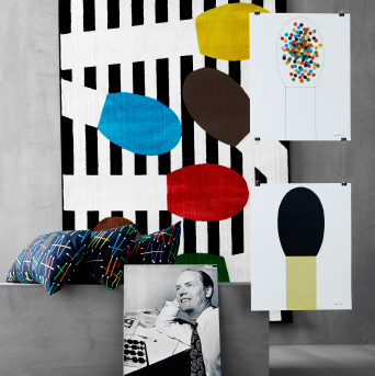 A display of cushions, posters and rugs with patterns of matches.