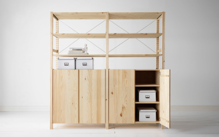 Two pine wood shelving units with cupboards on the lower halves placed side by side.
