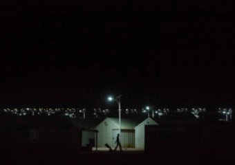 Solar powered streetlights illuminate Azraq refugee camp, helping refugee families to move safely and easily around at night
