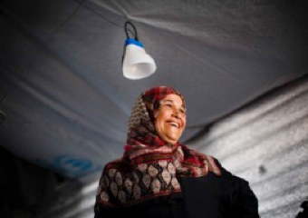 Emtyaz, pictured in her family shelter at Azraq Refugee camp with an IKEA Foundation solar lantern.