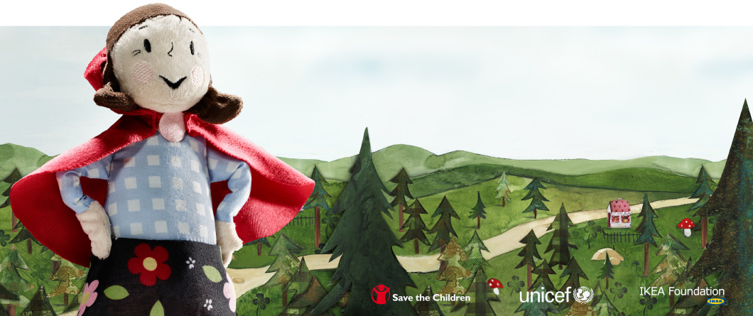 A smiling soft toy character standing against a forest-themed background, promoting donations to education.