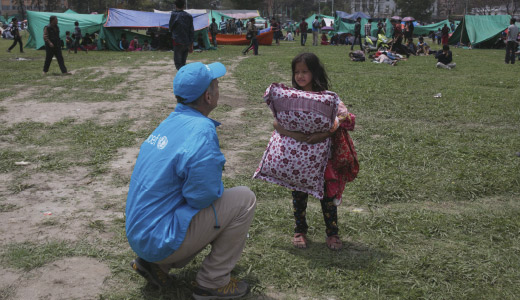 Unicef stuff talking with a girl in Nepal