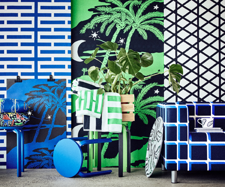 Display of a collection consisting of cushions with colourful patterns, towels with white, green, blue and black stripes, sofa cover with blue geometric pattern, pre-cut fabrics with green palm trees, white/blue brick pattern and white/black square pattern.