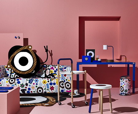 The egg-shaped character Darcel Disappoints relaxing in KLIPPAN sofa with FÖRNYAD patterned cover, shown in a living room.