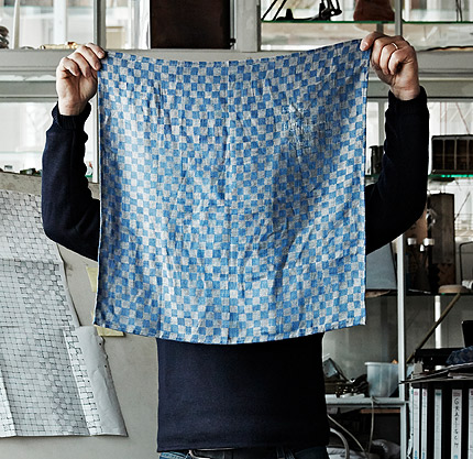 Dutch designer Piet Hein Eek hides behind the chequered blue tea towel he designed for the INDUSTRIELL collection.