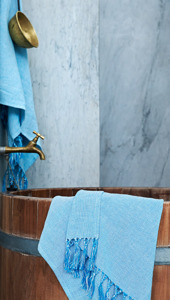 The INNEHÅLLSRIK collection includes handwoven and hand embroidered textiles in rich shades of blue.