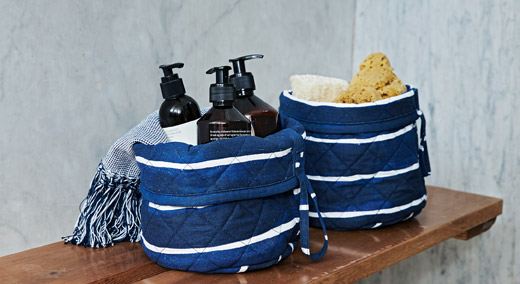 The handwoven baskets from the IKEA INNEHÅLLSRIK collection are perfect for storing things like dirty laundry.