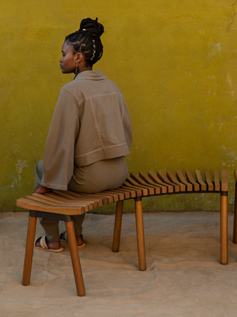 An ÖVERALLT curved bench made from pieces of solid eucalyptus wood.