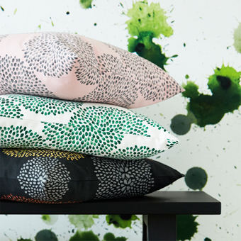 A pile of cushion covers in assorted colours and patterns.