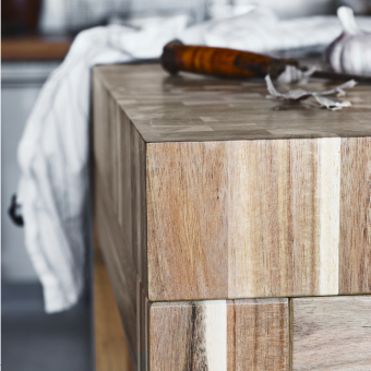 A close-up of a butcher's block table in solid acacia.