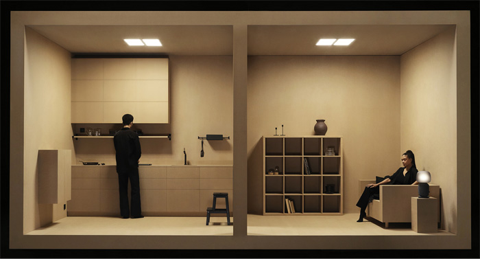 A cardboard-like cubed open living space with a man standing in a kitchen and a woman seated in a sofa near a SYMFONISK lamp.