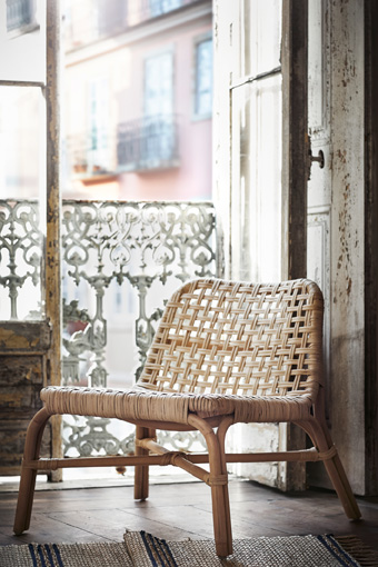 The TÄNKVÄRD easy chair in woven rattan.