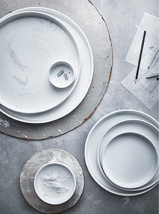 Several white serving plates made of stoneware, seen from above.