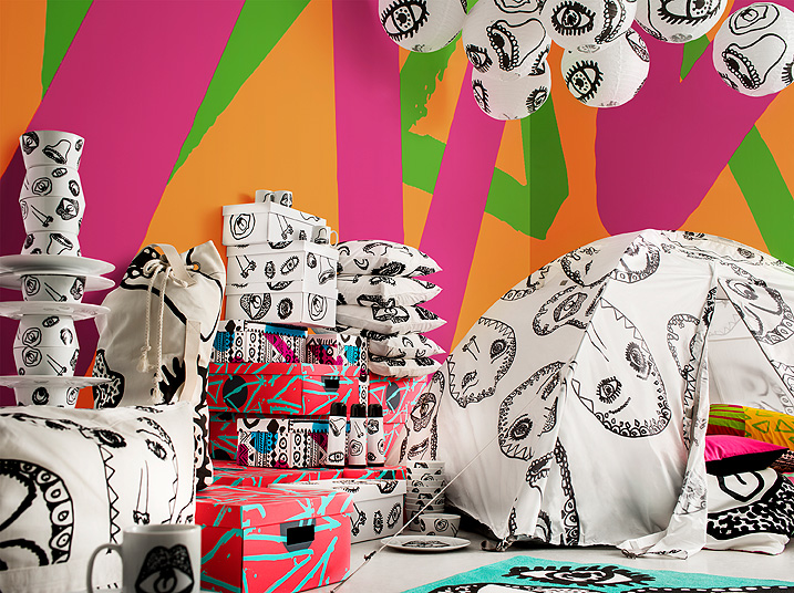 A display of a colourful collection with fun patterns consisting of tableware, boxes, textiles and a camping tent.