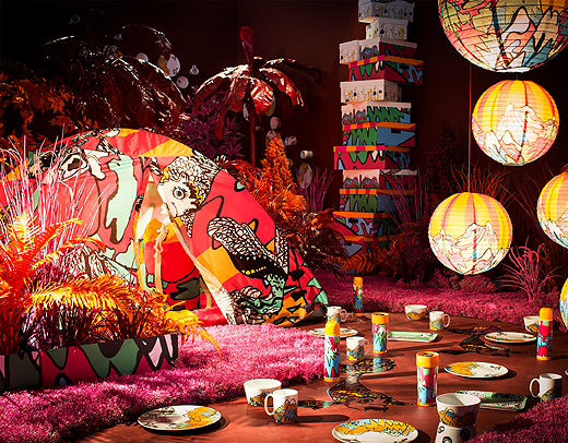 A display of a colourful collection with fun patterns consisting of tableware, boxes, lamp shades, textiles and a camping tent.