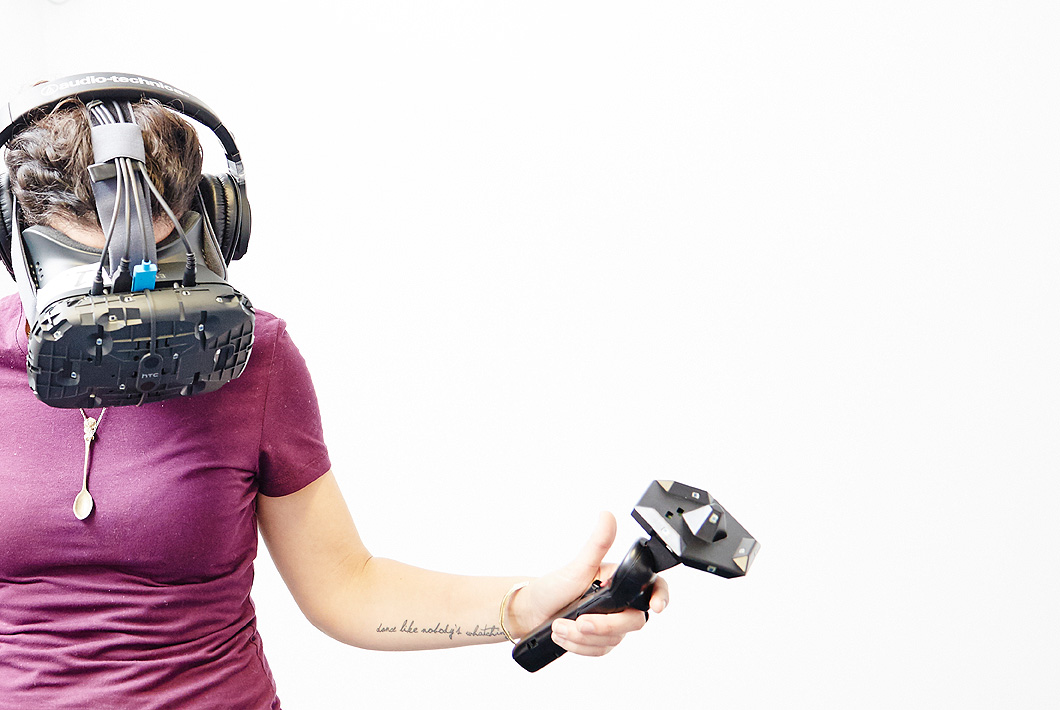 A WOMAN holding a vr gear