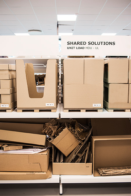 Shelves with different cardboard packages.