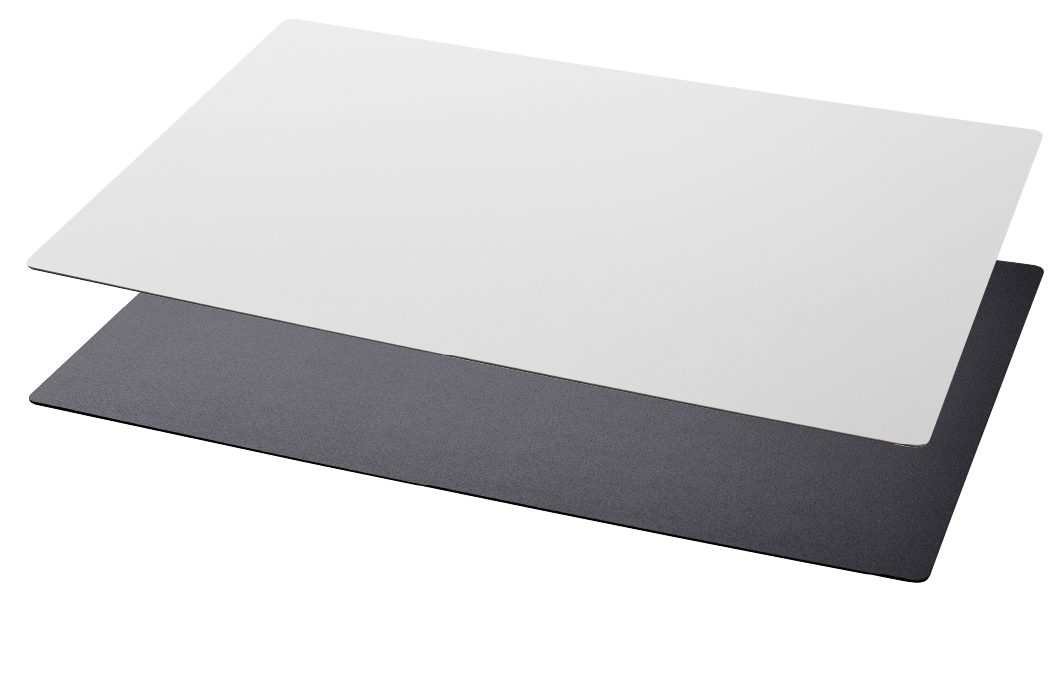 Two rectangular desk pads, one white and one black.