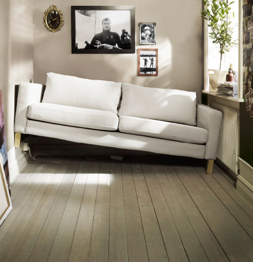 An IKEA KARLSTAD sofa wedged into a space that's too small for it.
