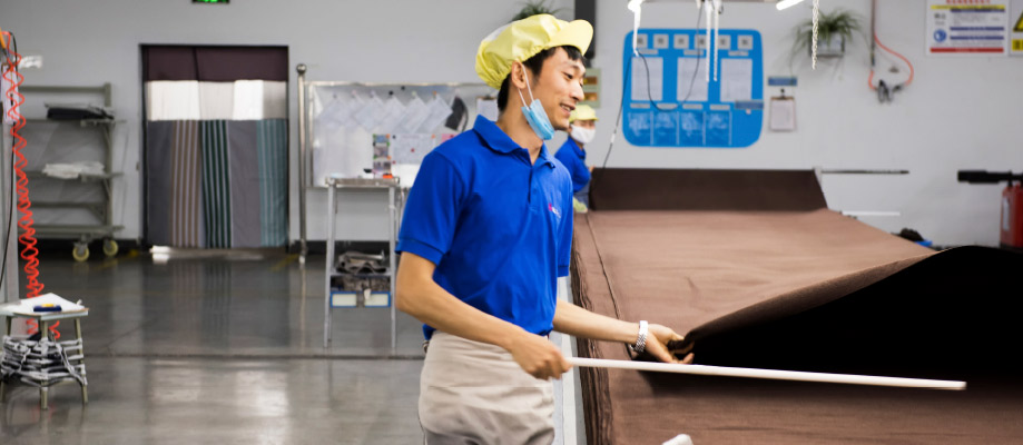 A worker at a plant that supplies IKEA with rugs.
