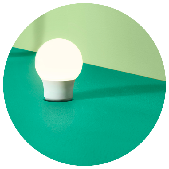A green circle containing the KEA RYET LED light bulb- a low price bulb that truly making LED affordable for the many.