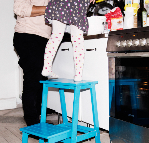 Father and daughter cooking in kitchen. In Stockholm home.