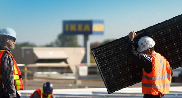 Men installing solar panels on an IKEA store