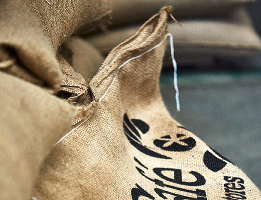 Close-up of a sack filled with coffee beans.