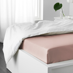The light pink IKEA DVALA fitted sheets are made with a more sustainable dyeing technique that saves on chemicals, energy and water.