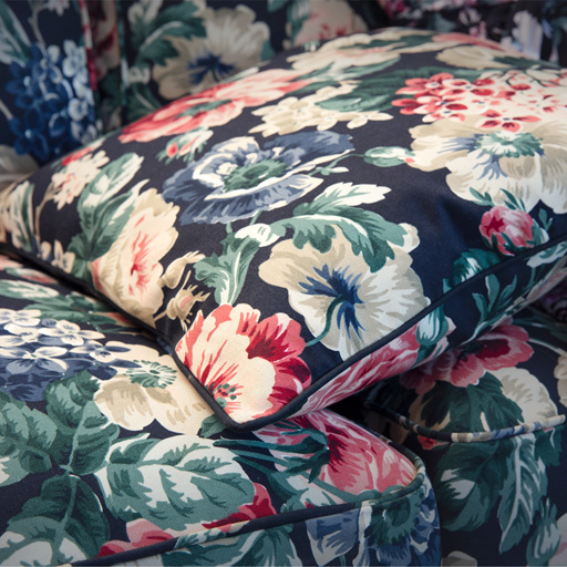 IKEA LEIKNY is a soft cushion cover with a floral pattern made from more sustainable cotton.