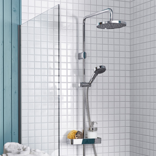 A BROGRUND shower in a white tiled bathroom with green details.