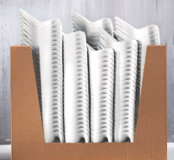 A stack of white IKEA PS VÅLLÖ water cans in a cardboard box