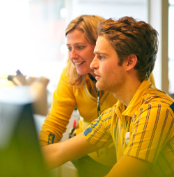 Two IKEA store co-workers looking up information on the computer