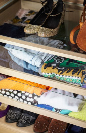 Close up of neatly folded clothes and shoes in KOMPLEMENT wardrobe organizers