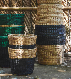 Close-up of NIPPRIG plant pots made from water hyacinths, stacked on top pf each other.