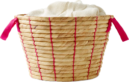 Close up of hand-woven basket with red handles