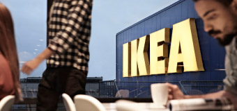The IKEA store logo reflected through the window of the IKEA restaurant