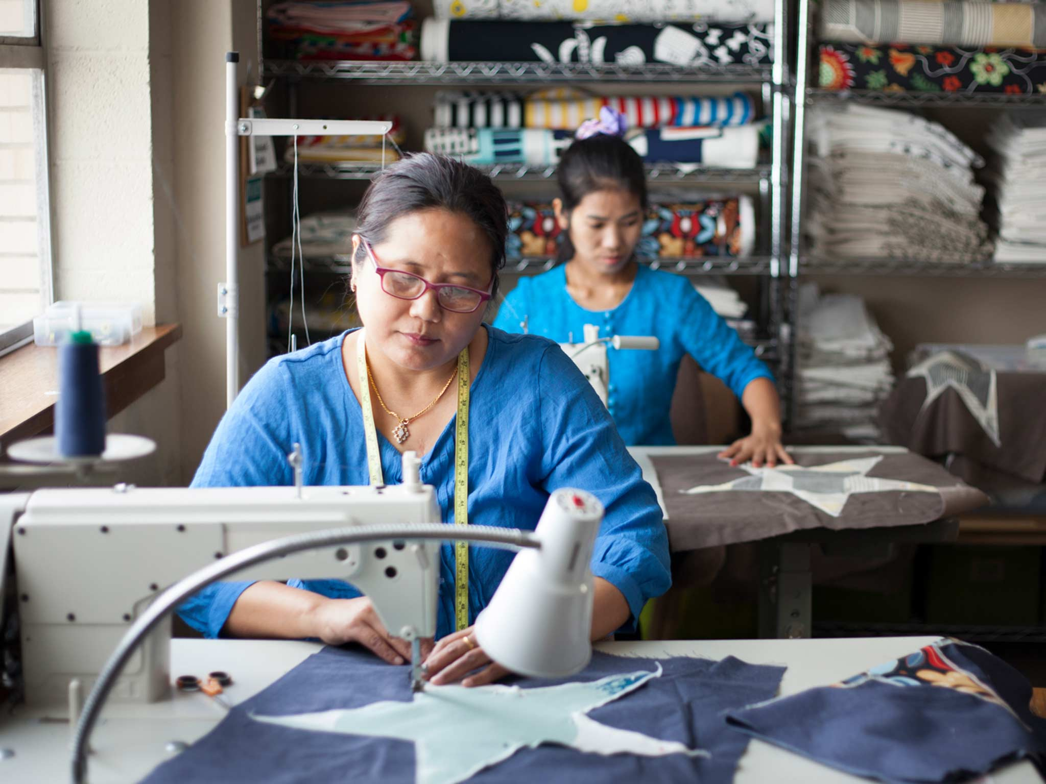 Open Arms is a social entrepreneur in Texas that offers refugee women employment. Thang Zuali turns leftover IKEA fabric into new products.