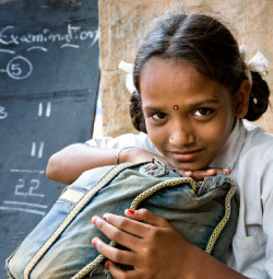 A young Indian girl in a classroom