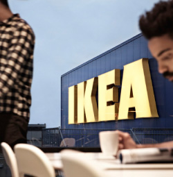 Young man having coffee at the IKEA store restaurant