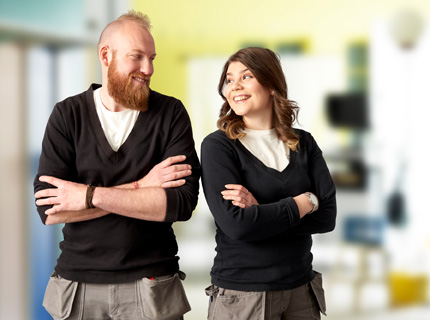 A man and a woman wearing the same working garments illustrate the IKEA ambition to reach gender balance in all positions.