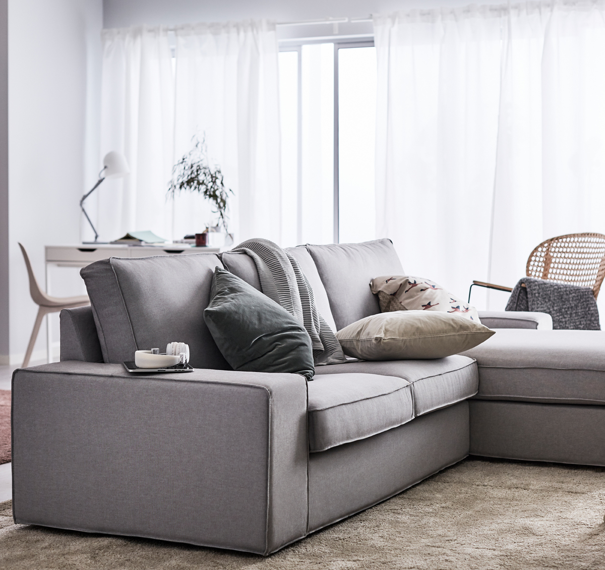 Grey Sectional KIVIK Sofa In A Beige And White Room, Paired With Neutral  Colour Cushions