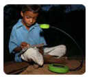 Child and solar lamp