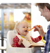 Infant getting fed buy parent