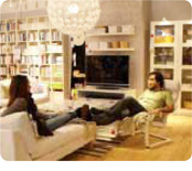 Woman and man relaxing in livingroom