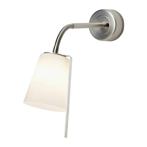 BASISK Wall spotlight   Adjustable head for easy directing of light.  Shades of mouth blown glass; each shade is unique.