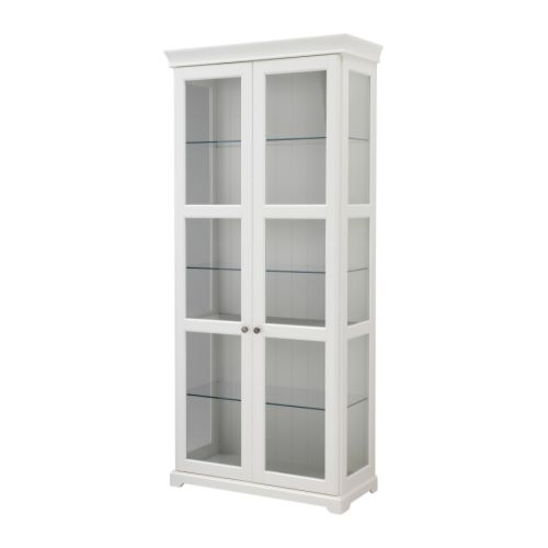 LIATORP Glass-door cabinet   3 adjustable glass shelves; adjust spacing according to your own storage needs.  2 fixed shelves for high stability.