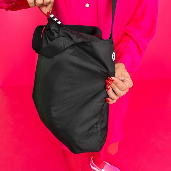 RÄCKLA Beg, boleh dilipat, hitam, 48x36 cm/20 l